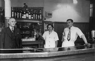 Interior view of the Ben Cleuch with John and Jimmy Simpson and barmaid Betty.